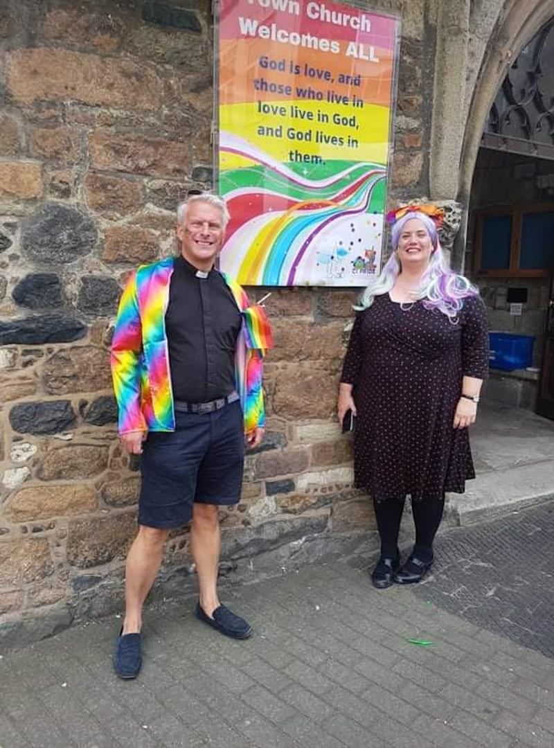 Ruth Abernethy and the Reverend Matthew Barrett in front of the Town Church, Guernsey