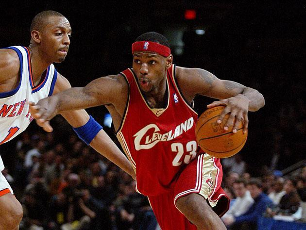 LeBron James drives on Penny Hardaway, because that's how long it's been. (Getty Images)