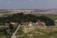The village of Luetzerath, Germany, is set to be evicted for the build of a coal mine, Tuesday, July 20, 2021. The village stands just a few hundred meters from a vast pit where German utility giant RWE is extracting lignite coal to burn in nearby power plants. (AP Photo/Bram Janssen)