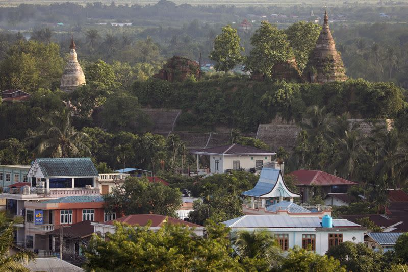 FILE PHOTO: Landscape view of downtown with ancient pagodas in the background in Mrauk U