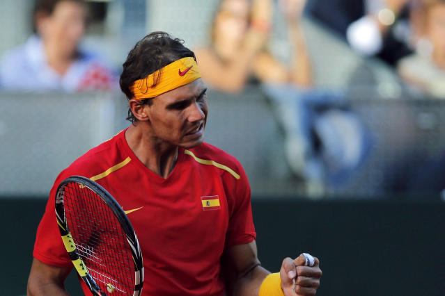 Spain's Rafael Nadal celebrates a point during a match against Ukraine's Sergiy Stakhovky on the first day of the World Group play-off Davis Cup tennis in Madrid, Spain, Friday, Sept. 13, 2013. (AP Photo/Andres Kudacki)