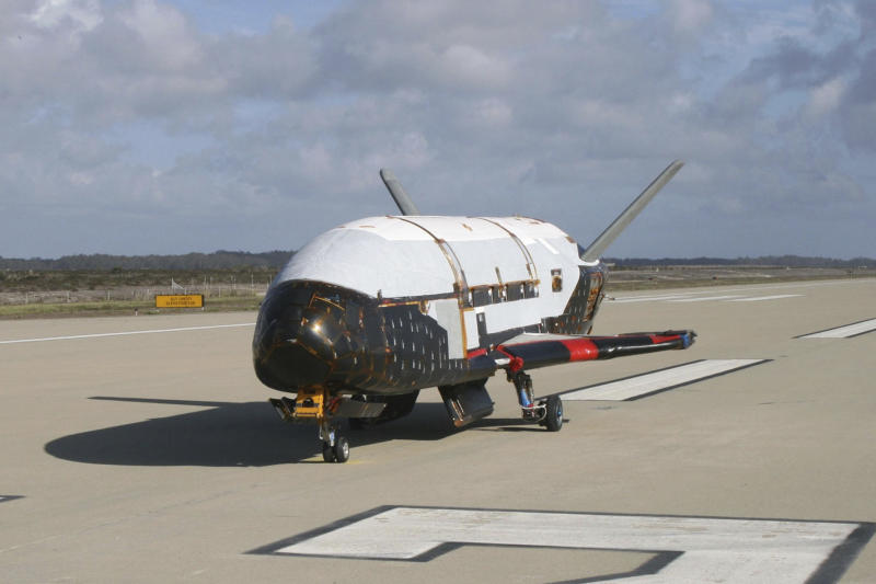 "This June 2009 photo provided by the U.S. Air Force via NASA shows the X-37B Orbital Test Vehicle at Vandenberg Air Force Base, Calif. President Donald Trump says there may someday be a ""space force"" fighting alongside the Air Force, Army and other branches of the military. Trump was speaking March 13, 2018, about his administration's investments in space exploration to members of the military when he said that space is becoming a ""war-fighting domain."" (U.S. Air Force via AP)"