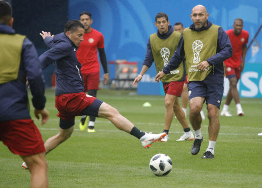 Costa Rica's Bryan Oviedo, left, and his teammates attend Costa Rica's official training on the eve of the group E match between Brazil and Costa Rica at the 2018 soccer World Cup in the St. Petersburg stadium in St. Petersburg, Russia, Thursday, June 21, 2018. (AP Photo/Dmitri Lovetsky)