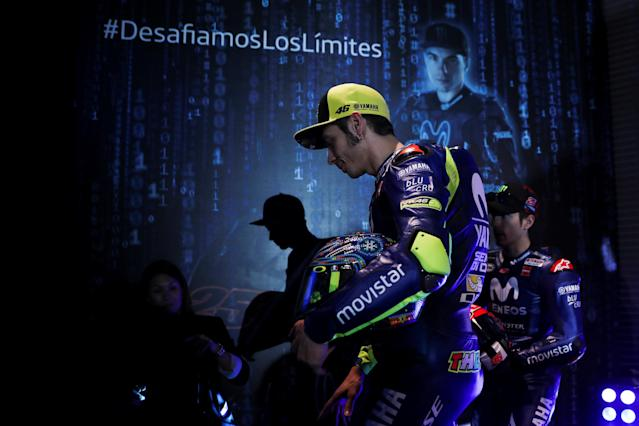Sport Motorcycling - Movistar Yamaha Team Presentation - Madrid, Spain - January 24, 2018 Movistar Yamaha's MotoGP riders Valentino Rossi of Italy and Maverick Vinales of Spain walk away after posing with their new bikes for the 2018 racing season. REUTERS/Susana Vera