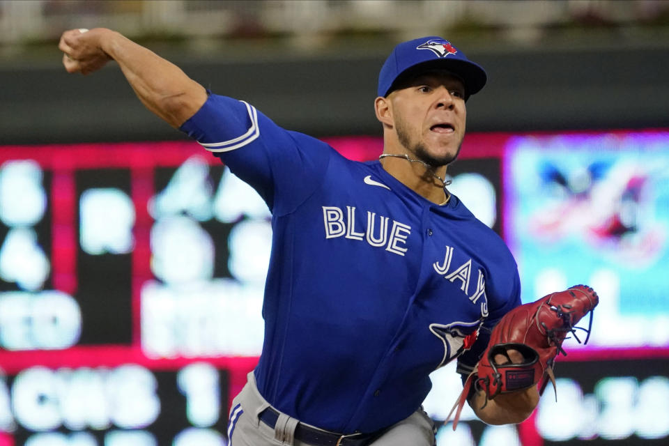Toronto Blue Jays pitcher Jose Berrios throws against his former team, the Minnesota Twins, in the first inning of a baseball game, Friday, Sept. 24, 2021, in Minneapolis. (AP Photo/Jim Mone)