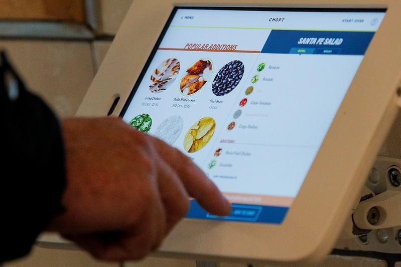 A customer places an order at the newest Chopt Creative Salad Co., location in New York