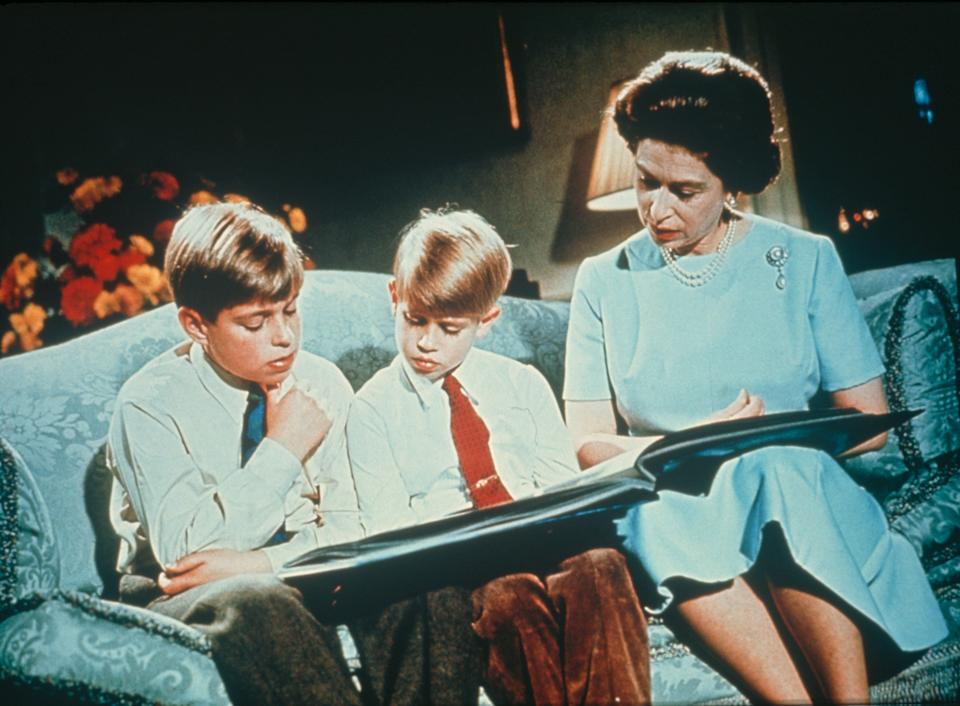 Queen Elizabeth looking at a photo album with Prince Andrew (left) and Prince Edward in December 1971. Footage of this scene was used in the queen's Christmas broadcast of 1971, to illustrate the theme of family.