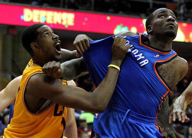 Cleveland Cavaliers Tristan Thompson (L) battles for position with Oklahoma City Thunders Kendrick Perkins (R) during the seond quarter of their NBA basketball game in Cleveland, February 2, 2013.REUTERS/Aaron Josefczyk (UNITED STATES - Tags: SPORT BASKETBALL TPX IMAGES OF THE DAY) - RTR3DADJ