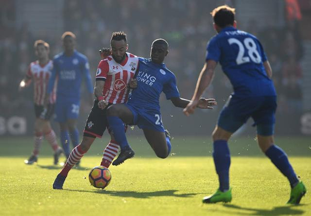 <p>Nampalys Mendy does not let Nathan Redmond past him </p>