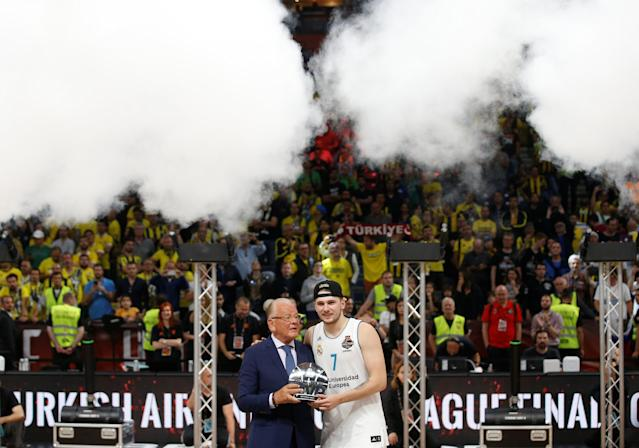 Basketball - Euroleague Final Four Final - Real Madrid vs Fenerbahce Dogus Istanbul - Stark Arena, Belgrade, Serbia - May 20, 2018 Real Madrid's Luka Doncic is presented with the MVP award by Dusan Ivkovic REUTERS/Alkis Konstantinidis