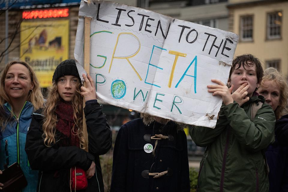 BRISTOL, ENGLAND - FEBRUARY 28: Supporters hold a banner as they wait to catch a glimpse of Swedish environmentalist Greta Thunberg as she joins demonstrators during a Bristol Youth Strike 4 Climate (BYS4C) march, on February 28, 2020 in Bristol, England.  (Photo by Leon Neal/Getty Images)