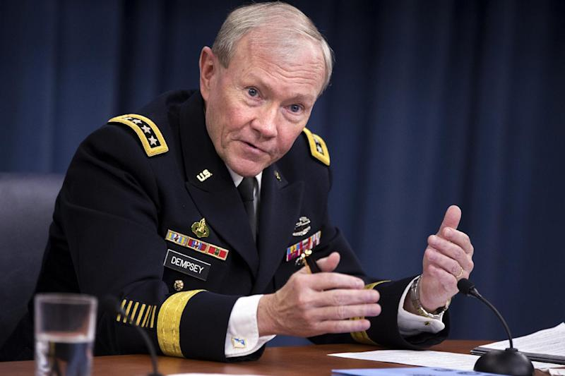 FILE - In this March 28, 2013 file photo, Joint Chiefs Chairman Gen. Martin Dempsey gestures while speaking during a news conference at the Pentagon. The top U.S. military official says North Korea's bellicose rhetoric, including threats to attack the United States, follows its decades-long pattern of provocation followed by non-violent accommodation. Dempsey said Friday the situation is worrisome, given the stakes. But he suggested that it does not appear to point toward war.  (AP Photo/Jacquelyn Martin, File)