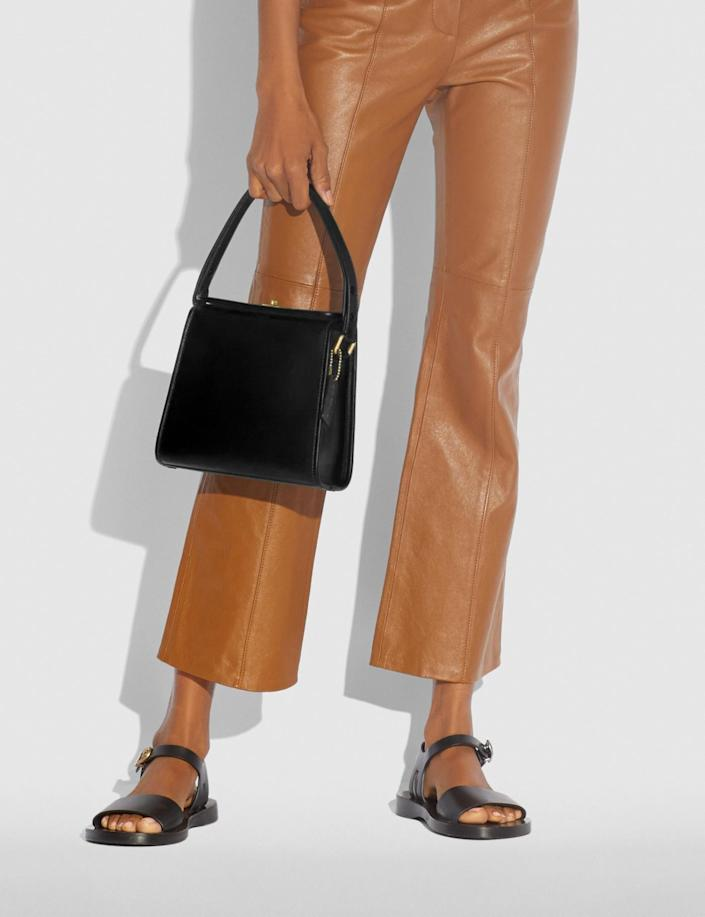 <p>We love the chic look of this <span>Coach Turnlock Shoulder Bag</span> ($395).</p>