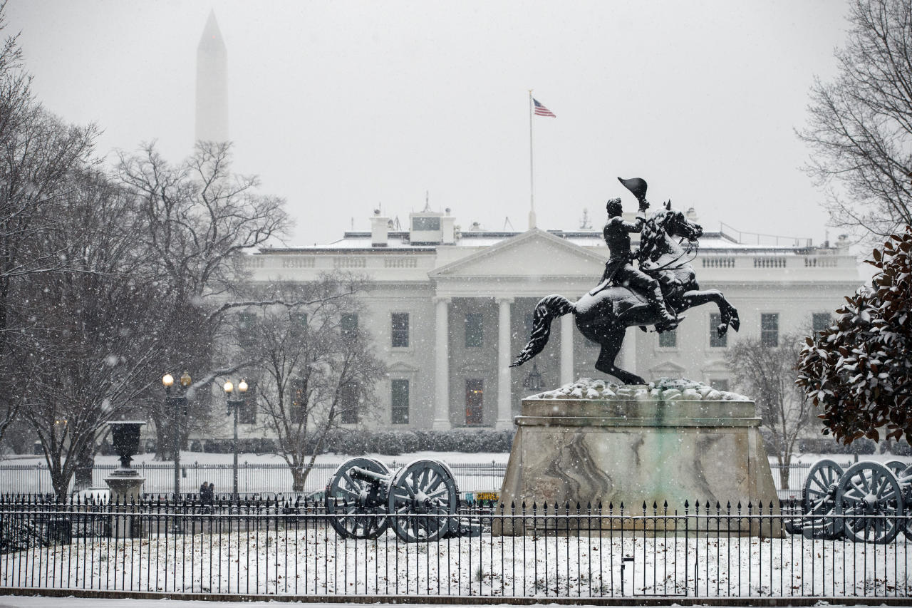 Snow falls on the White House during a winter storm, Wednesday, Feb. 20, 2019, in Washington. (AP Photo/ Evan Vucci)