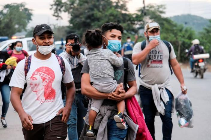 Hondurans take part in a new caravan of migrants, set to head to the United States, in San Pedro Sula