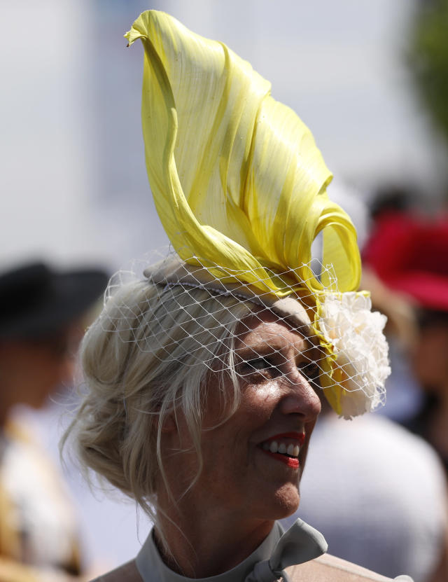 Britain Horse Racing - Derby Festival - Epsom Racecourse - June 2, 2017 Racegoer during the Derby Festival Reuters / Peter Nicholls Livepic EDITORIAL USE ONLY.