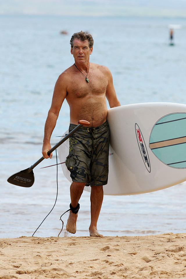 """""""Mamma Mia!"""" star Pierce Brosnan keeps fit by doing some stand-up paddleboarding in Hawaii. <a href=""""http://www.splashnewsonline.com/"""" target=""""new"""">Splash News</a> - June 14, 2008"""