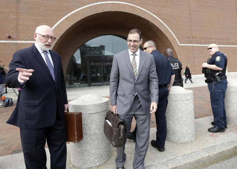 """Defense attorneys J.W. Carney Jr., left, and Henry Brennan, right, leave federal court in Boston, Monday, June 3, 2013, after a pre-trial hearing for accused mobster James """"Whitey"""" Bulger. Jury selection begins Tuesday. (AP Photo/Elise Amendola)"""