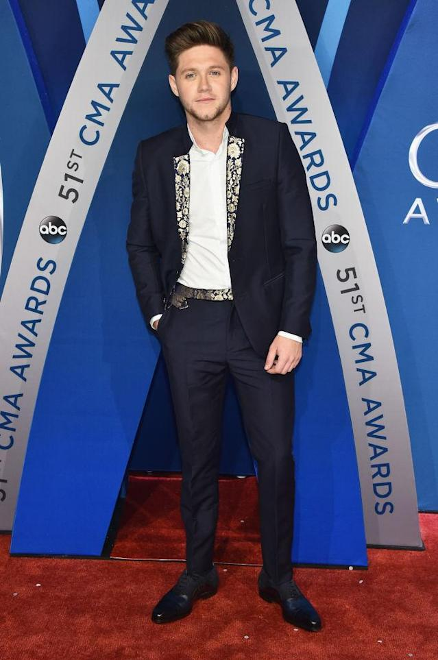 <p>The former member of One Direction wears a stylish suit before his debut CMA performance. (Photo: Getty Images) </p>