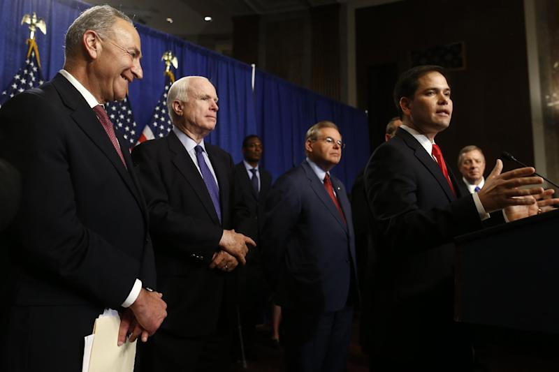 Sen. Marco Rubio, R-Fla., second from right, speaks on immigration reform legislation during a news conference on Capitol Hill in Washington, Thursday, April 18, 2013. From left are, Sen. Charles Schumer, D-N.Y.; Sen. John McCain, R-Ariz.; Sen. Robert Menendez, D-N.J.; Rubio, and Senate Majority Whip Richard Durbin of Ill. (AP Photo/Charles Dharapak)