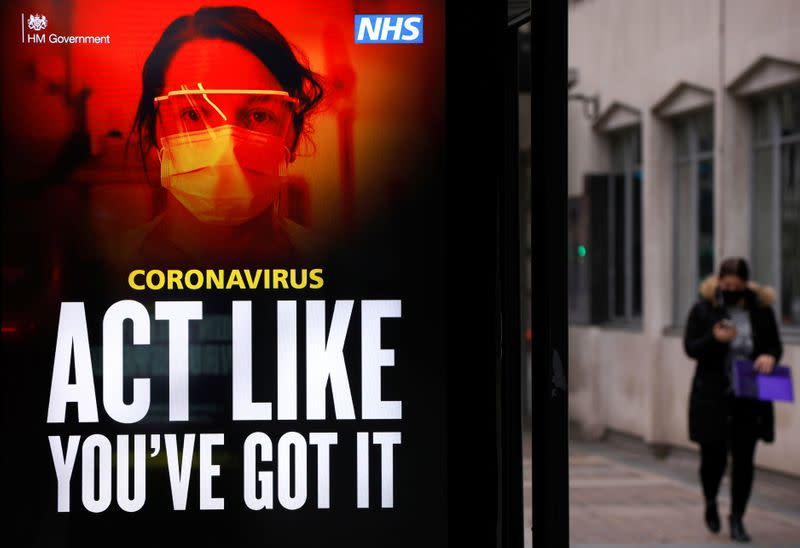 A government COVID-19 advertisement is seen amid the outbreak of the coronavirus disease in London