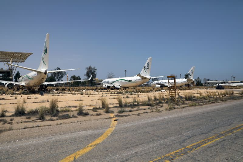 FILE PHOTO: Airplanes are seen at Tripoli airport after Libya's internationally recognised government regained control over the city, in Tripoli