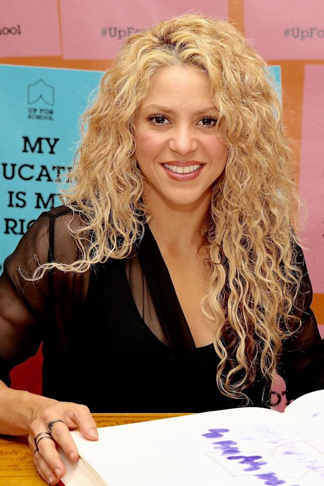 "<p>The Colombian singer is known for her textured <a rel=""nofollow"" href=""http://www.redbookmag.com/beauty/hair/features/g2901/natural-hairstyles/"">natural hair</a>, which she often wears untamed and voluminous.</p>"