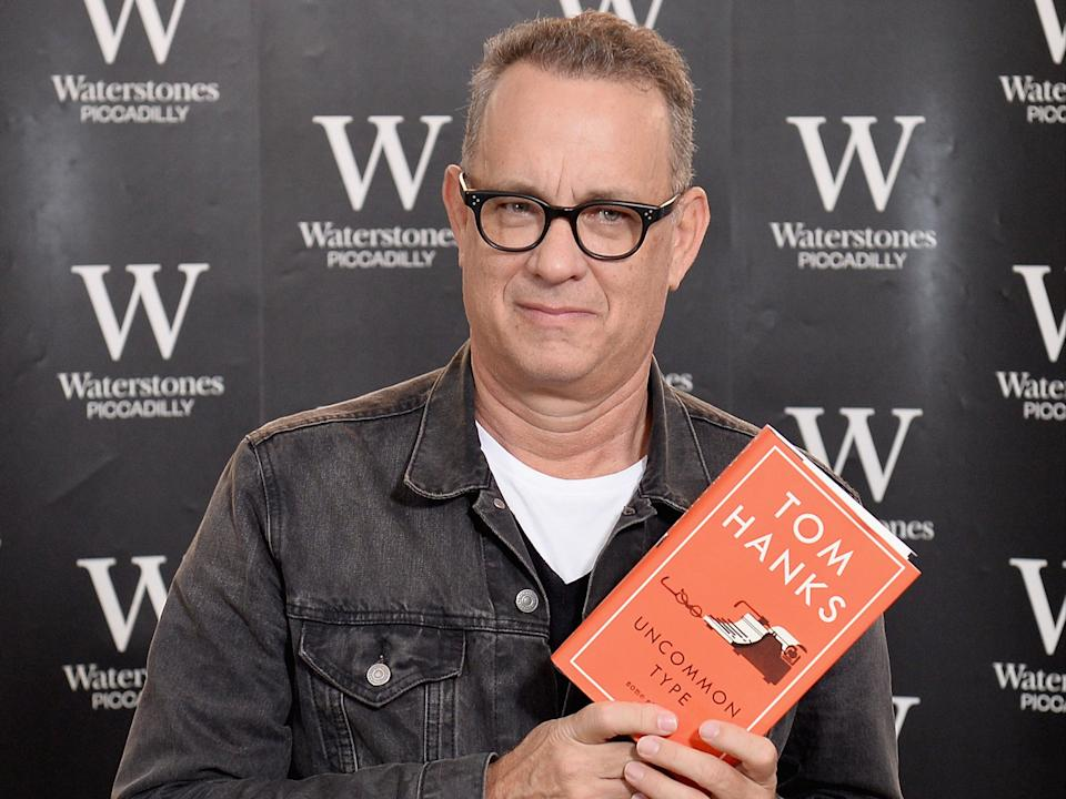 Hanks for the memories: The 'Forrest Gump' star poses with his 2017 short story collection 'Uncommon Type' (Getty Images)