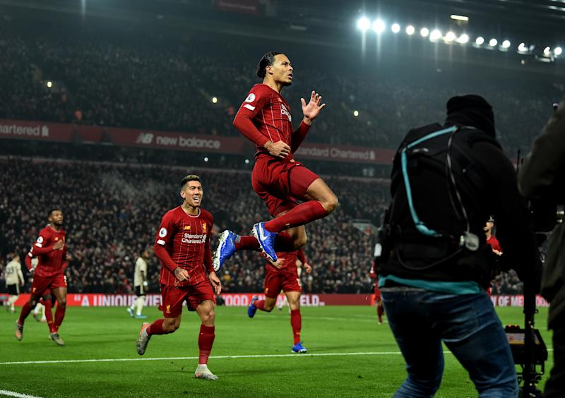 Virgil van Dijk (right) gave Liverpool an early lead on Sunday against Manchester United. (Photo by Andrew Powell/Liverpool FC via Getty Images)