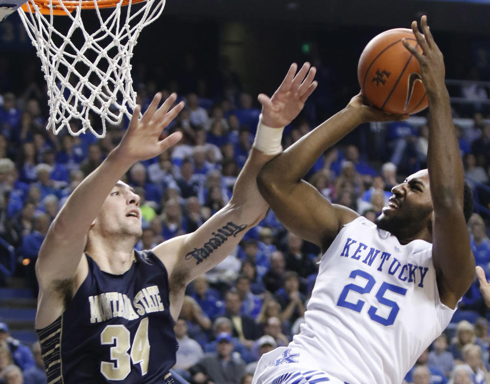 Kentucky's Dominique Hawkins (25) shoots as Montana State's Danny Robison (34) defends during the first half of an NCAA college basketball game, Sunday, Nov. 23, 2014, in Lexington, Ky. (AP Photo/James Crisp)