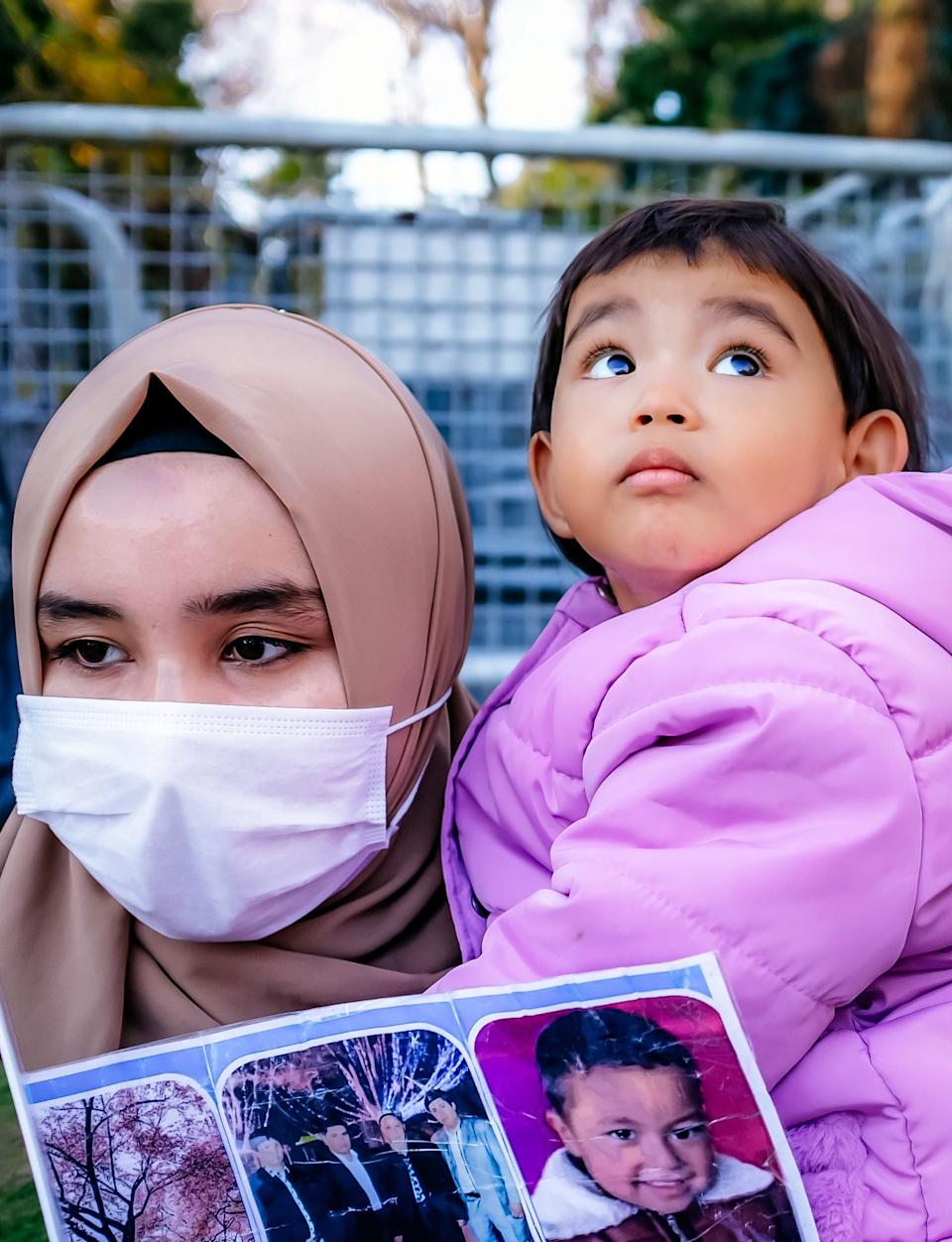 A member of the Muslim Uighur minority holds a child in her arms as she demonstrates in front of the Chinese consulate in Istanbul last month (Photo by BULENT KILIC/AFP via Getty Images) (AFP via Getty Images)