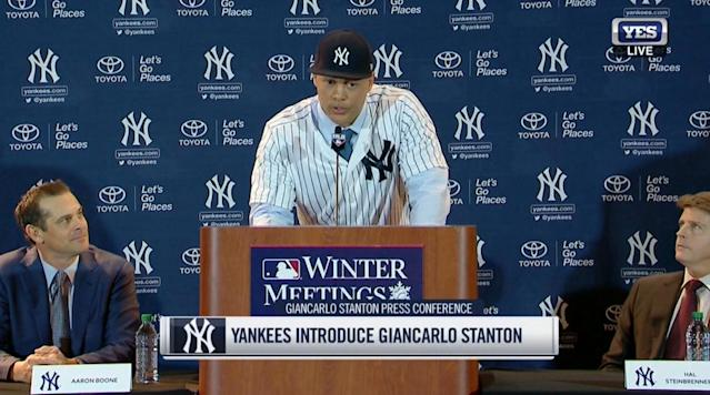 "<p>The New York Yankees officially announced their trade with the Miami Marlins that sends 2017 National League MVP Giancarlo Stanton and cash considerations to the Bronx in exchange for second baseman Starlin Castro, minor league right-handed pitcher Jorge Guzman and minor league infielder Jose Devers.</p><p>Stanton was introduced as a Yankee for the first time at the Winter Meetings in Orlando, Fla.</p><p>Before his introduction, Stanton posted the following photo on Instagram and took a shot at the Marlins' front office.</p><p>In his press conference, he said that there was ""no structure"" with the Marlins and their front office. It was clear to Stanton that Marlins part-owner Derek Jeter wanted to take the team through another rebuild. The Marlins had deals lined up with the San Francisco Giants and St. Louis Cardinals but neither team was on a list of places that Stanton would waive his no-trade clause for. He told reporters that he met with those clubs out of respect but rejected both deals.</p><p>Stanton relayed a message to Marlins fans and said to ""hang in there"" and ""maybe watch from afar"" as the team is expected to struggle. The Marlins have not made the postseason since 2003.</p><p>Stanton <a href=""http://si.fanatics.com/MLB_New_York_Yankees"" rel=""nofollow noopener"" target=""_blank"" data-ylk=""slk:will wear No. 27 with the Yankees"" class=""link rapid-noclick-resp"">will wear No. 27 with the Yankees</a>. He also said that he is is willing to play anywhere that Yankees manager Aaron Boone sees fit and would also shift to left field.</p><p>Stanton is coming off a season in which he led the majors with 59 home runs, 132 RBIs and 91 extra-base hits. He has $295 million remaining on his contract over the next 10 years and the Yankees are expected to pay about $265 million of that. He has the option to opt out of his contract and become a free agent after the 2020 season.</p>"
