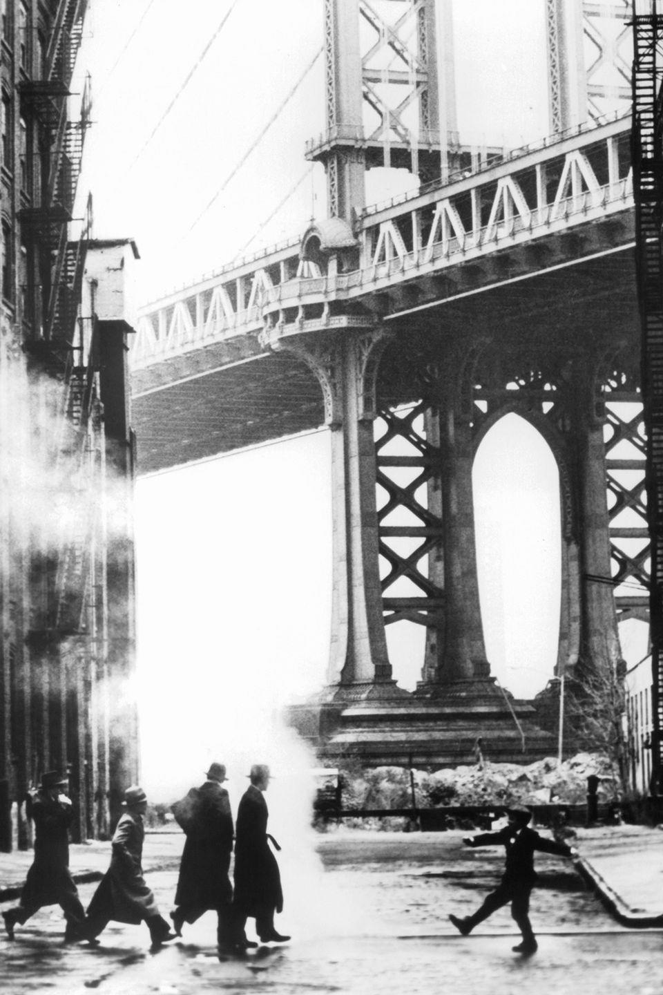 "<p>The Williamsburg Bridge rises high above New York's streets in a scene from the film <em><a href=""https://www.amazon.com/Once-Upon-Time-America-Pesci/dp/B001EC2J2U?tag=syn-yahoo-20&ascsubtag=%5Bartid%7C10052.g.21054733%5Bsrc%7Cyahoo-us"" rel=""nofollow noopener"" target=""_blank"" data-ylk=""slk:Once Upon A Time In America"" class=""link rapid-noclick-resp"">Once Upon A Time In America</a>.</em></p>"