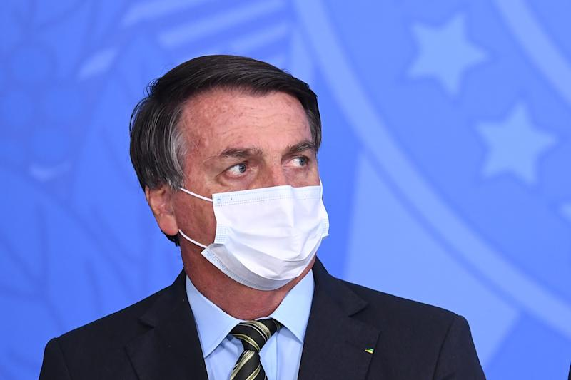 """Brazilian President Jair Bolsonaro attends the event """"Brazil beating COVID-19"""" at Planalto Palace in Brasilia, on August 24, 2020. - Brazilian President Jair Bolsonaro threatened on Sunday a journalist who questioned him about the first lady's alleged participation in an illegal payment scheme. (Photo by EVARISTO SA / AFP) (Photo by EVARISTO SA/AFP via Getty Images)"""
