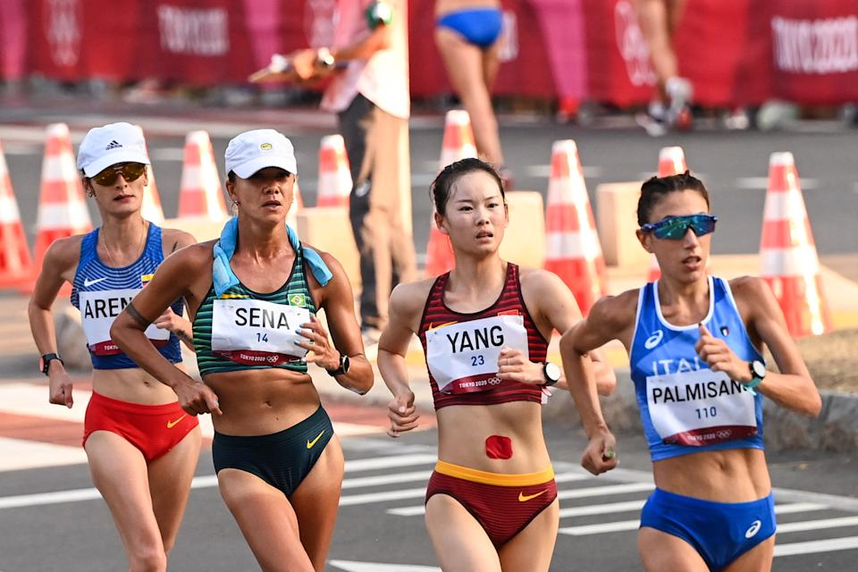 (From front to back) Italy's Antonella Palmisano, China's Yang Jiayu, Brazil's Erica Rocha De Sena and Colombia's Sandra Lorena Arenas compete in the women's 20km race walk final during the Tokyo 2020 Olympic Games at the Sapporo Odori Park in Sapporo on August 6, 2021. / AFP / Charly TRIBALLEAU