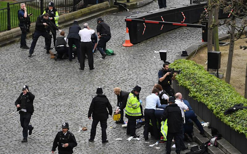 Masood, top left, is taken down by armed police while Pc Palmer gets medical attention, bottom right - Credit: PA