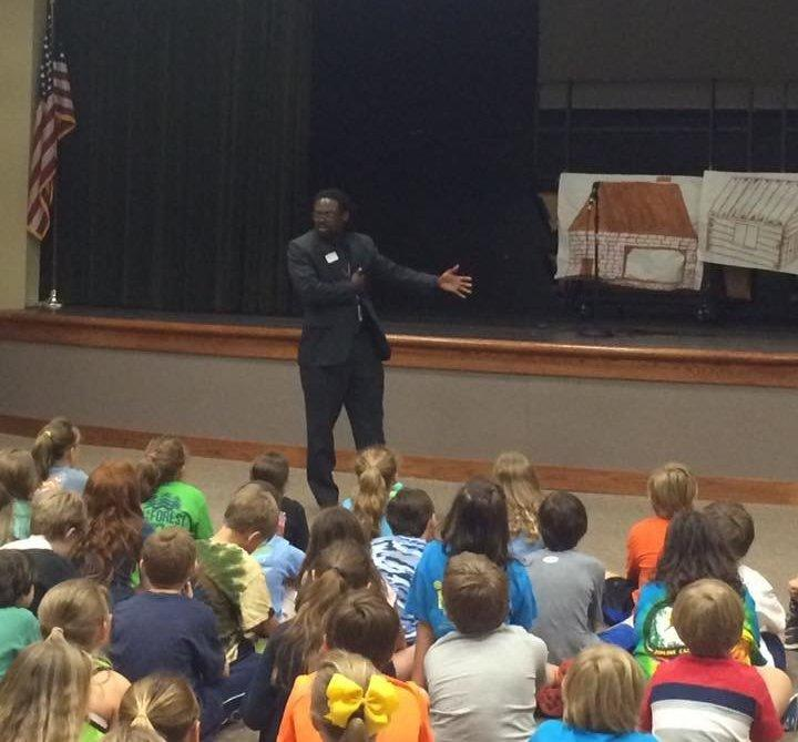 Charles Woods teaching young students about the civil rights movement