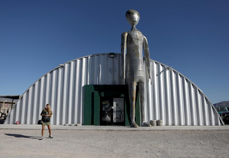 People visit the Alien Research Center in Hiko, as an influx of tourists responding to a call to 'storm' Area 51, a secretive U.S. military base believed by UFO enthusiasts to hold government secrets about extra-terrestrials, is expected in Rachel, Nevada, Sept. 19, 2019. (Photo: Jim Urquhart/Reuters)