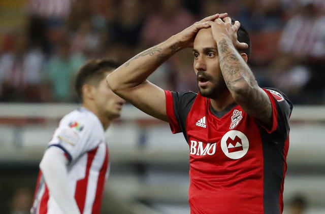 Toronto FC's Victor Vazquez holds his head in disbelief after being called out for a foul during the CONCACAF Champions League final soccer match against Chivas, in Guadalajara, Mexico, Wednesday, April, 25, 2018. (AP Photo/Eduardo Verdugo)
