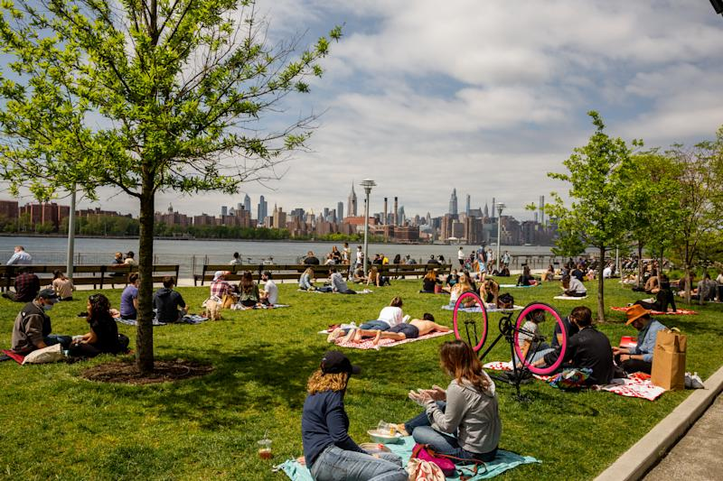 People visit Domino Park in the Williamsburg neighborhood of Brooklyn, May 24, 2020. (Sarah Blesener/The New York Times)