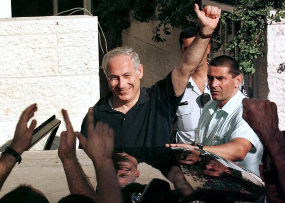 Benjamin Netanyahu celebrates winning in 1996 after that year's May elections, receiving 50.4 per cent of the vote to Shimon-Peres' 49.5 per cent (Reuters/ Jim Hollander)