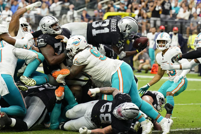Las Vegas Raiders running back Peyton Barber (31) dives in for a touchdown against the Miami Dolphins during the second half of an NFL football game, Sunday, Sept. 26, 2021, in Las Vegas. (AP Photo/Rick Scuteri)
