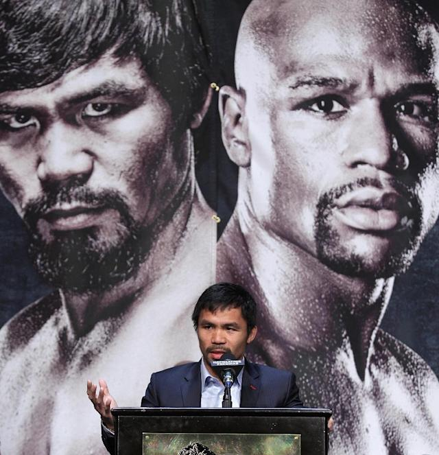 WBO welterweight champion Manny Pacquiao speaks during a news conference at the KA Theatre at MGM Grand Hotel & Casino on April 29, 2015 in Las Vegas, Nevada (AFP Photo/John Gurzinski)