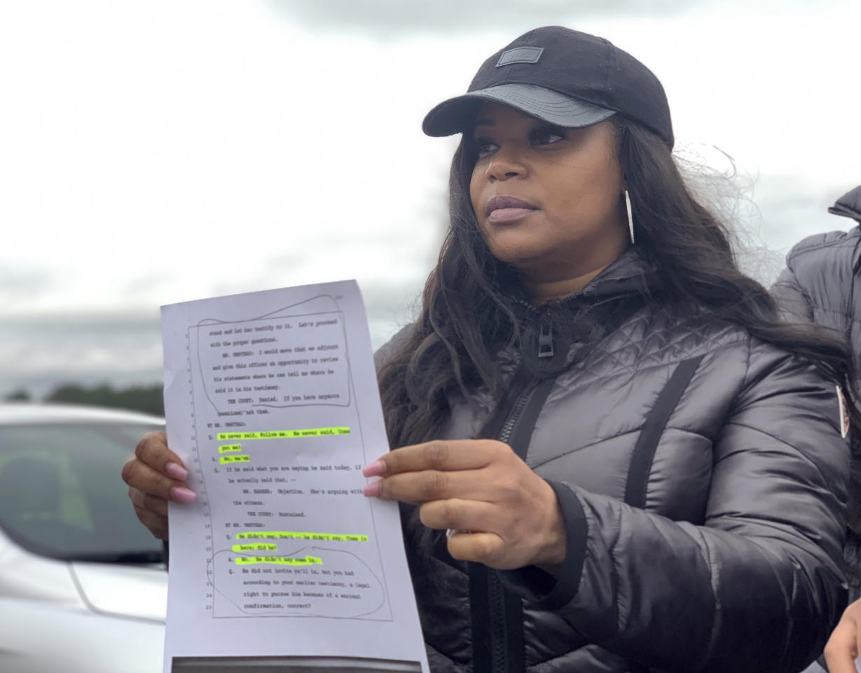 Pamela Woods, sister of condemned Alabama inmate Nathaniel Woods, speak to reporters outside Holman Correctional Facility ahead of his scheduled execution on Thursday, March 5, 2020 in Atmore, Alabama. His sister, Pamela Woods, holds a page from the trial transcript that she shows that her brother was surrendering when three police officers were shot by another man in 2004. Woods was convicted of capital murder as an accomplice in the shootings.  (AP Photo/Kimberly Chandler)