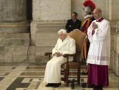 FILE PHOTO: Emeritus Pope Benedict XVI sits near the Holy Door as Pope Francis leads a mass to mark opening of the Catholic Holy Year, or Jubilee, in St. Peter's Square, at the Vatican