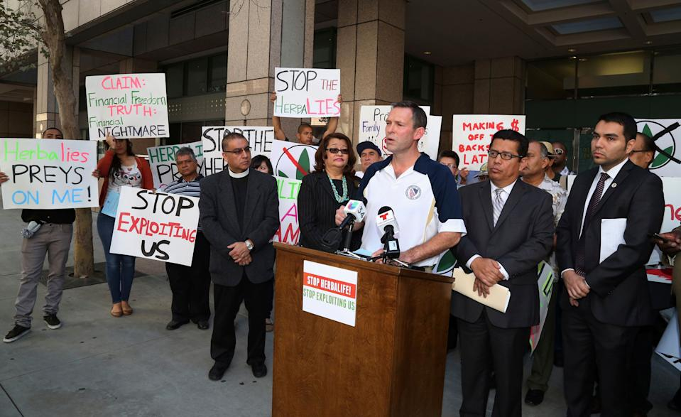 Brent Wilkes, national executive director of the League of United Latin American Citizens, speaks as demonstrators protest against Herbalife, a nutrition and supplements company, outside the Ronald Reagan State Office building in Los Angeles, California October 18, 2013.  (Photo: Fred Prouser/Reuters)