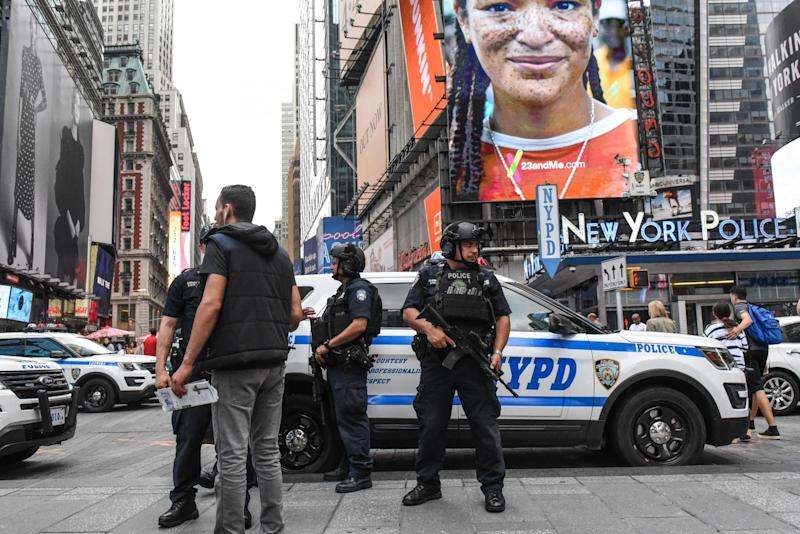 Members of the New York City Police Counterterrorism force stand guard in Times Square: Stephanie Keith/Getty Images