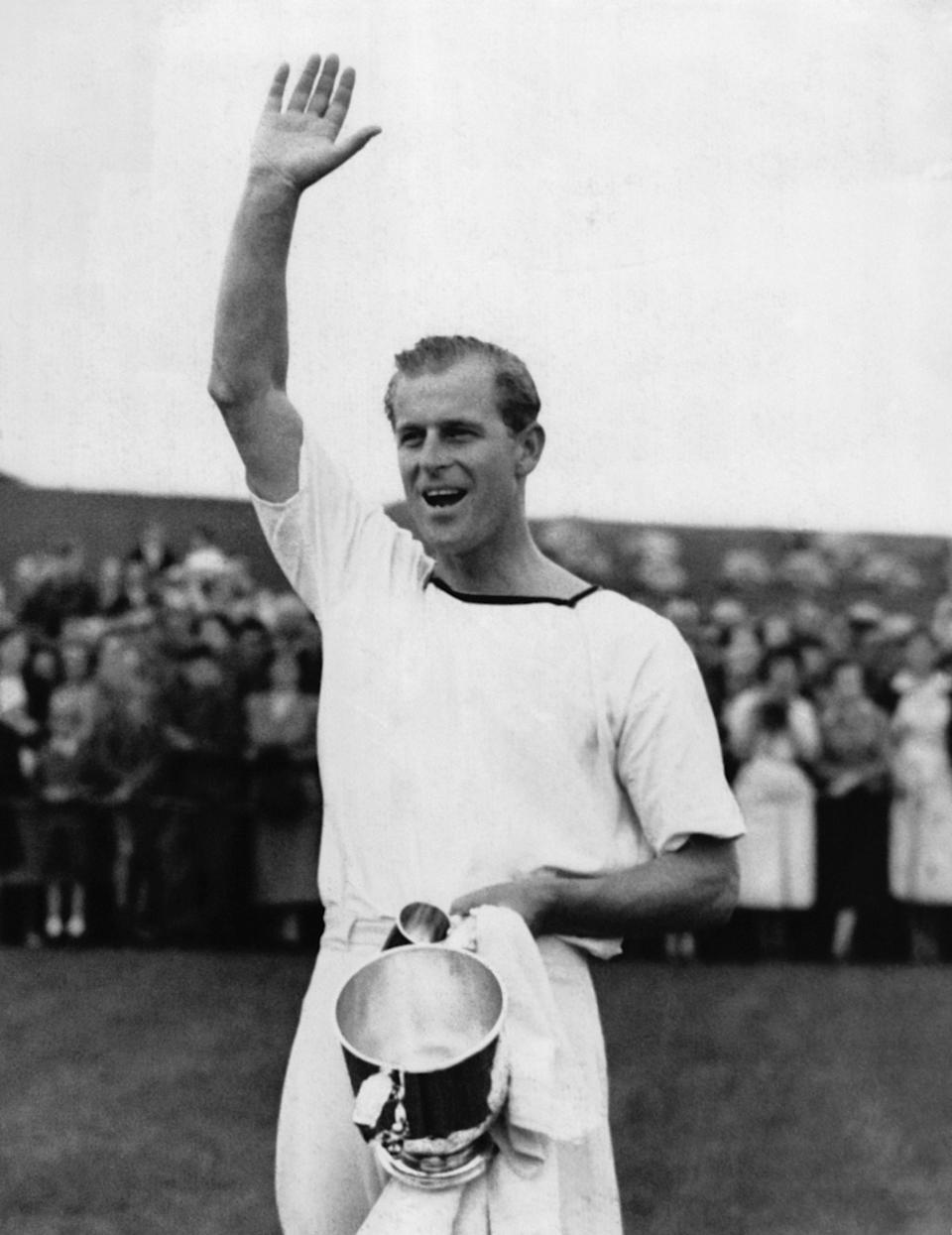 <p>Keen polo player Philip led a cheer after in winning a match in May 1954. Photo: Getty Images.</p>