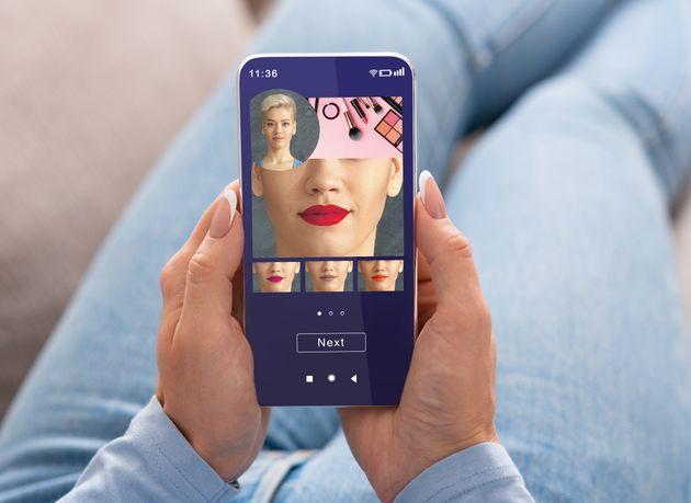 Augmented Reality Beauty App. Woman Trying Different Lipstick Color Online On Smartphone, Using Modern Application With AR Makeup Simulation, Creative Collage (Photo: Prostock-Studio via Getty Images/iStockphoto)