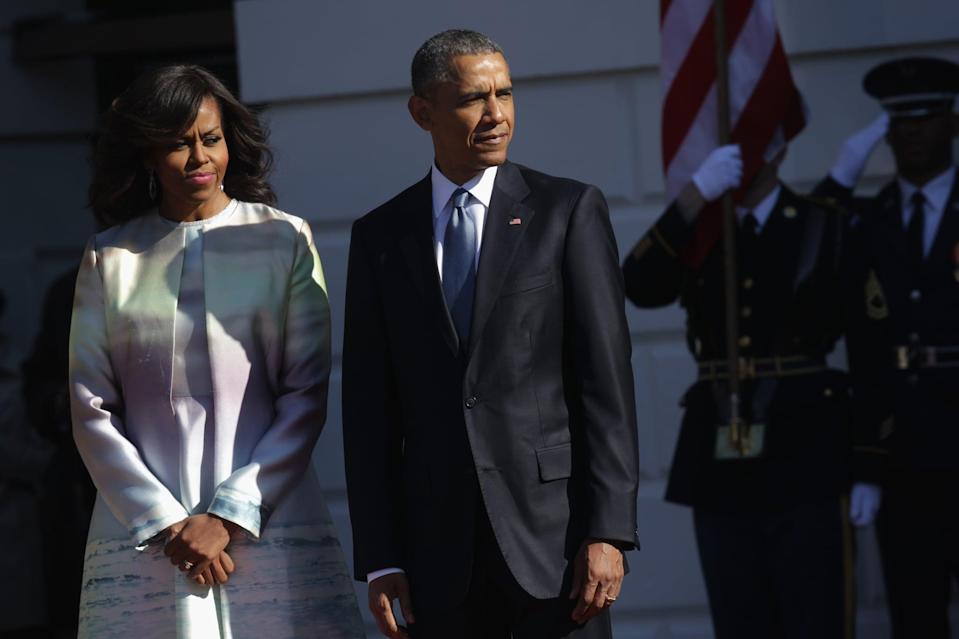 WASHINGTON, DC - APRIL 28:  (AFP OUT) U.S. President Barack Obama (R) and first lady Michelle Obama (L) wait for the arrival of Japanese Prime Minister Shinzo Abe and his wife Akie Abe during an official arrival ceremony at the South Lawn of the White House April 28, 2015 in Washington, DC. The Japanese Prime Minister and his wife are on an official visit to Washington.  (Photo by Alex Wong/Getty Images)